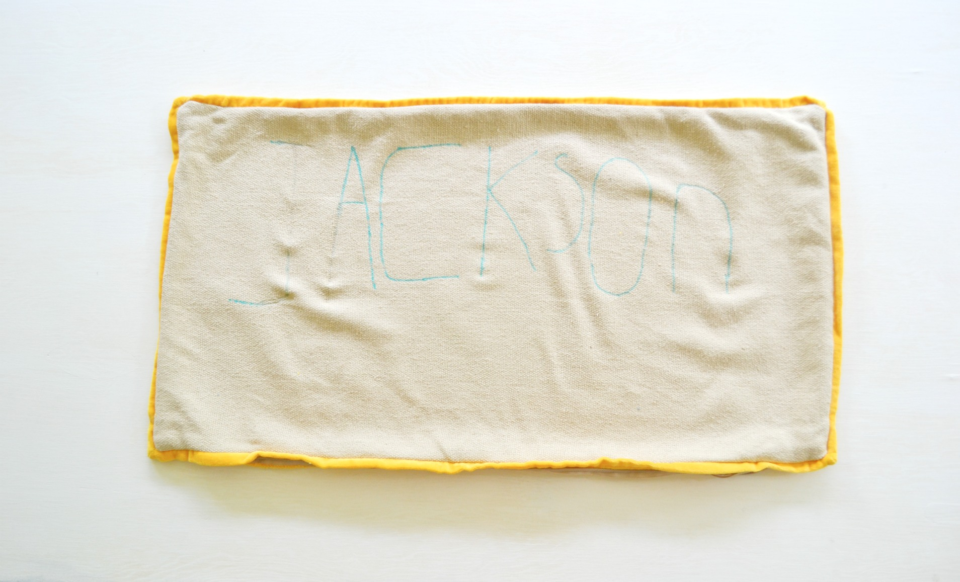 writing name on pillow